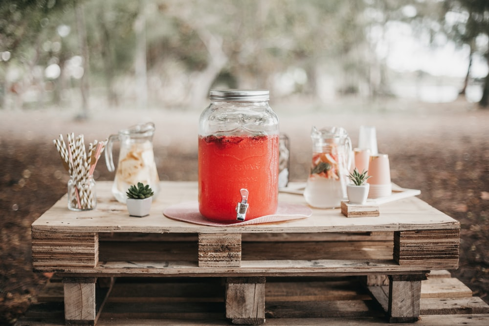 red juice in clear glass jar