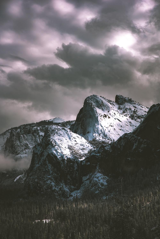 mountain peak under gray clouds