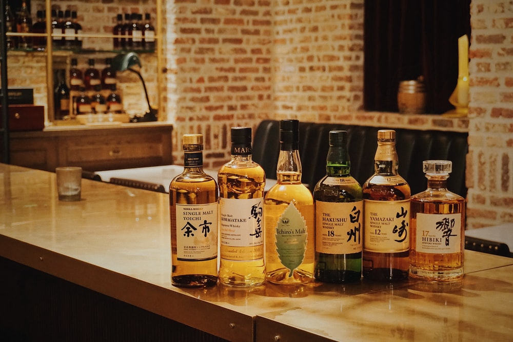 six liquor bottles