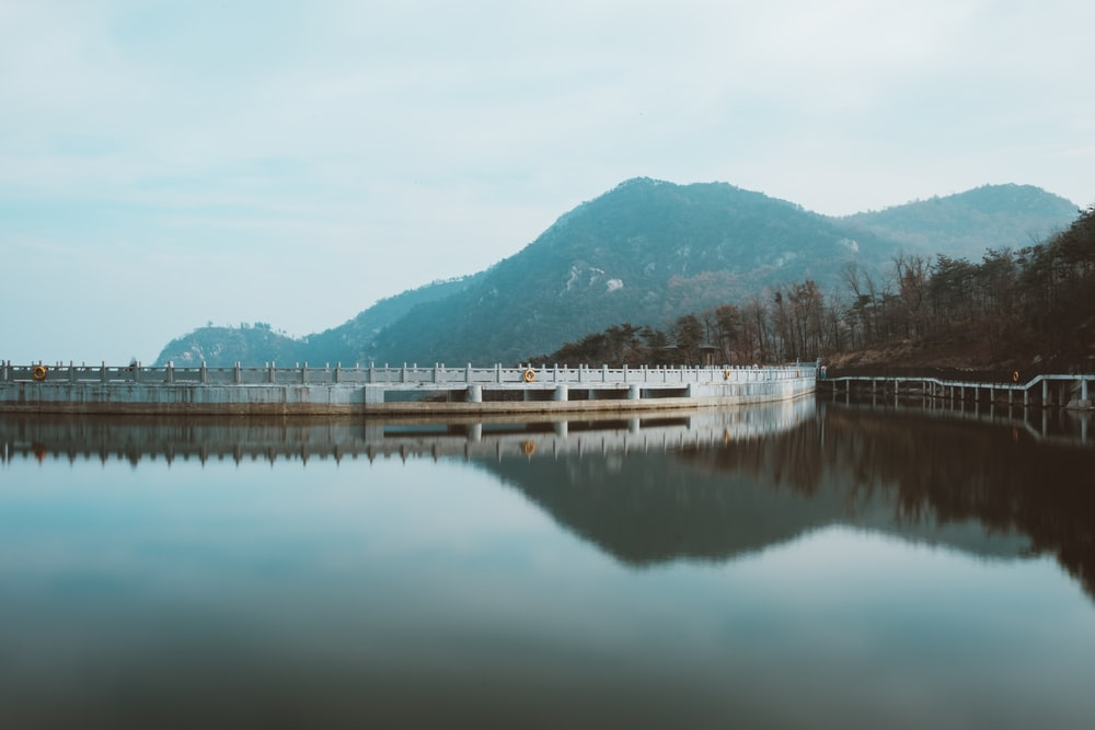 water in dam under clear blue sky