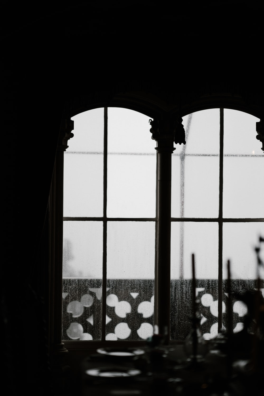 grayscale photo of closed window