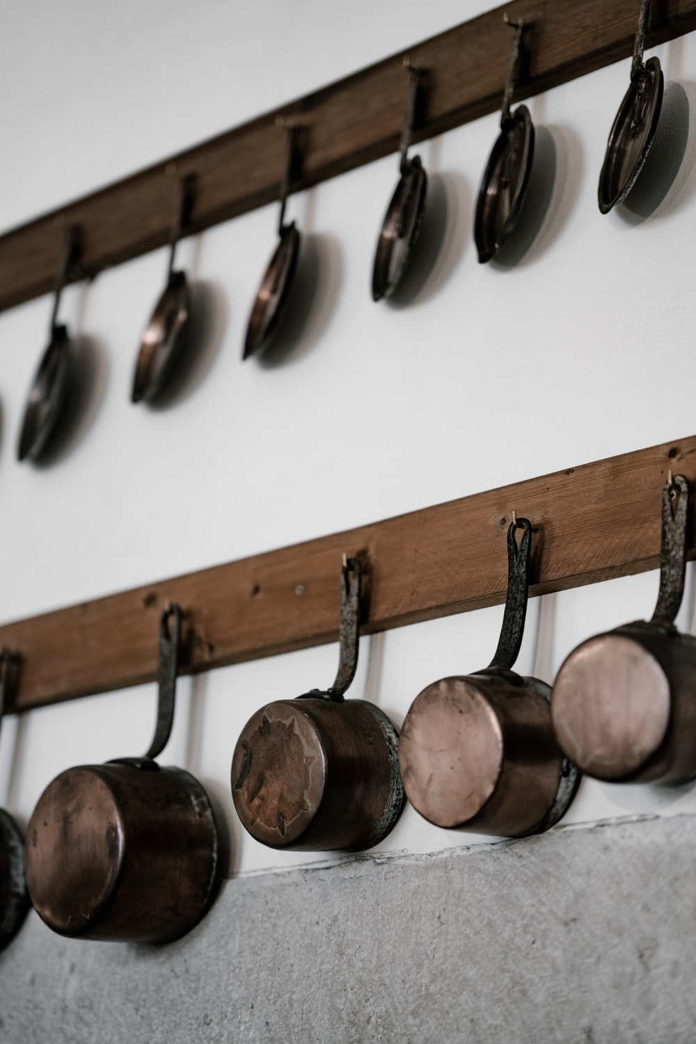 frying pan and saucepan in rack