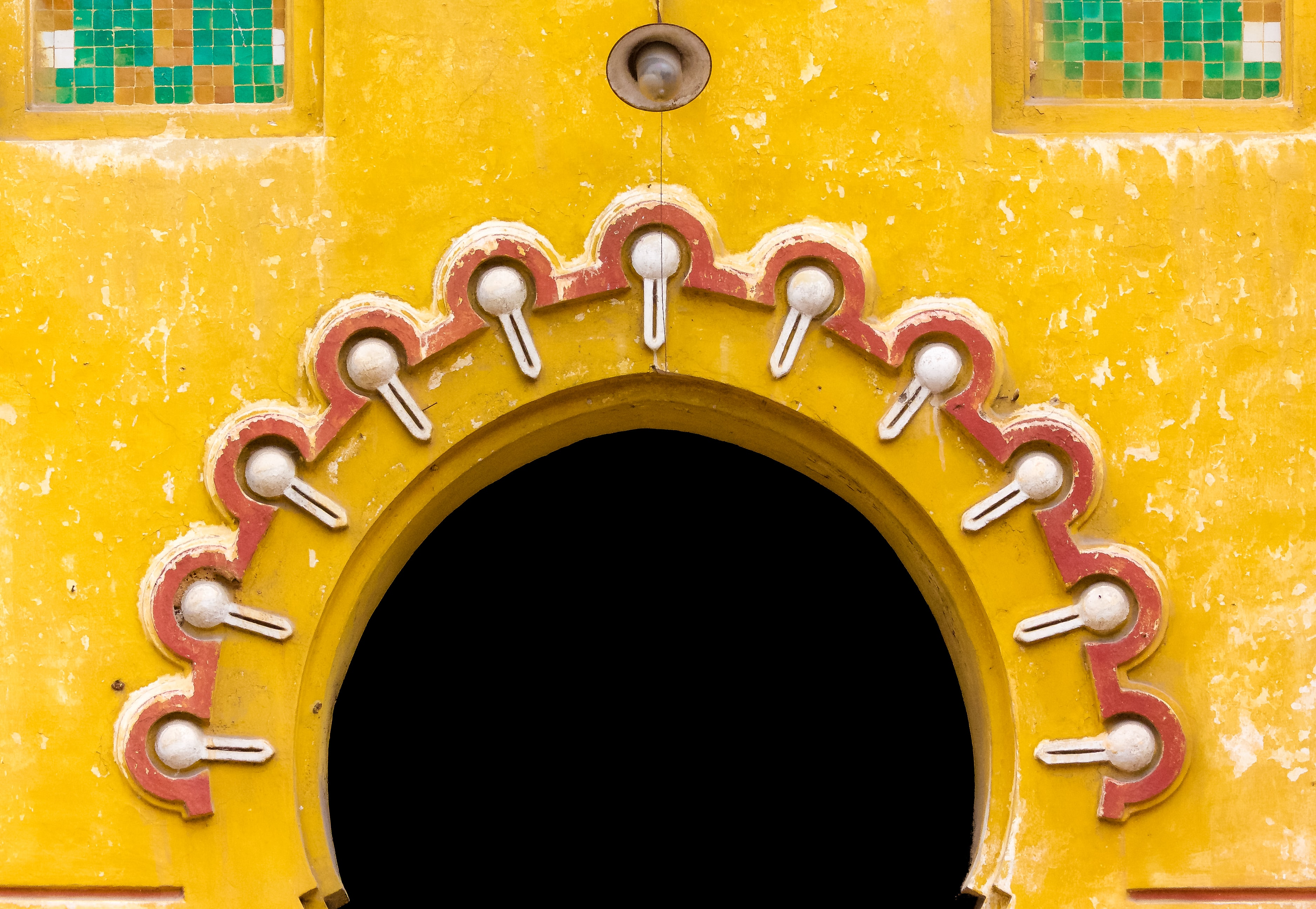 close-up photography of yellow and multicolored wall decors