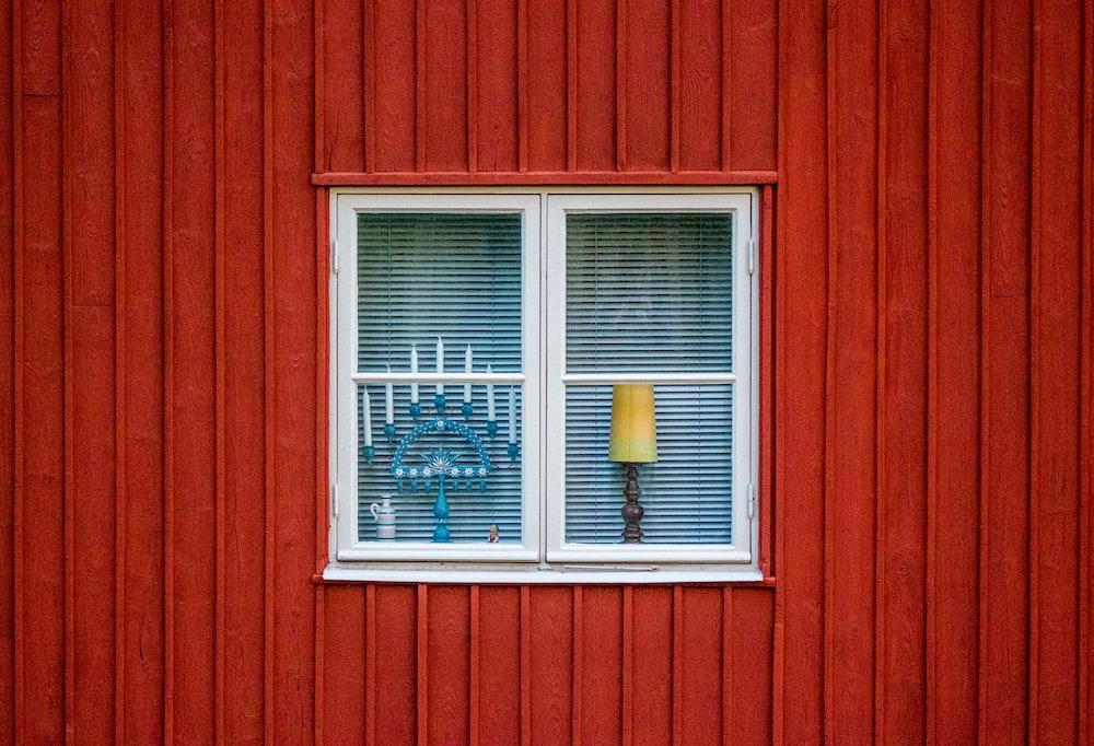 blue candelabra through glass window