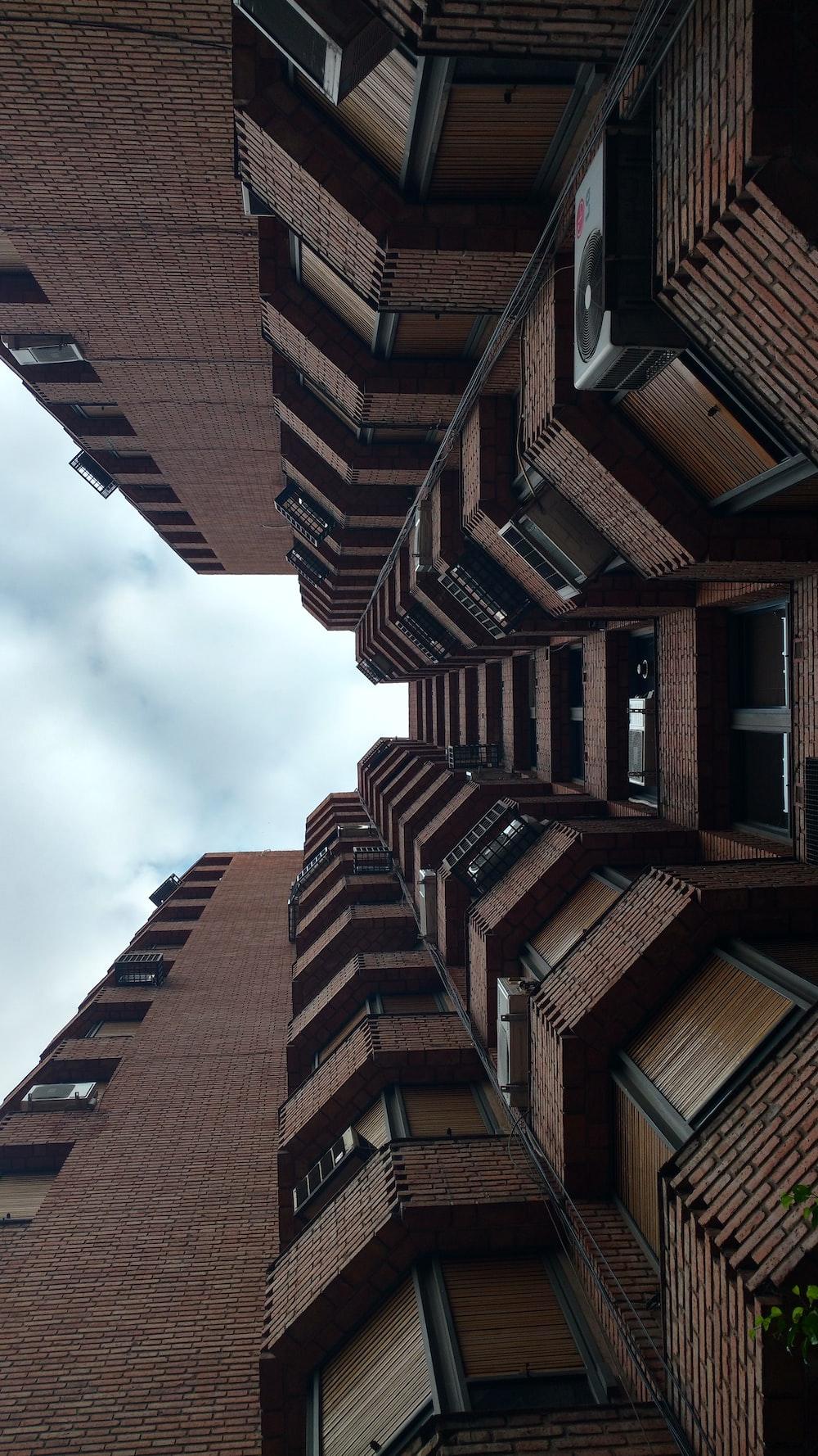 worm's eye view of brick buildings