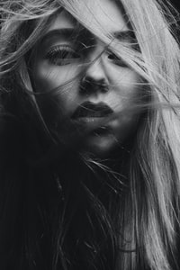 grayscale photography of woman's face