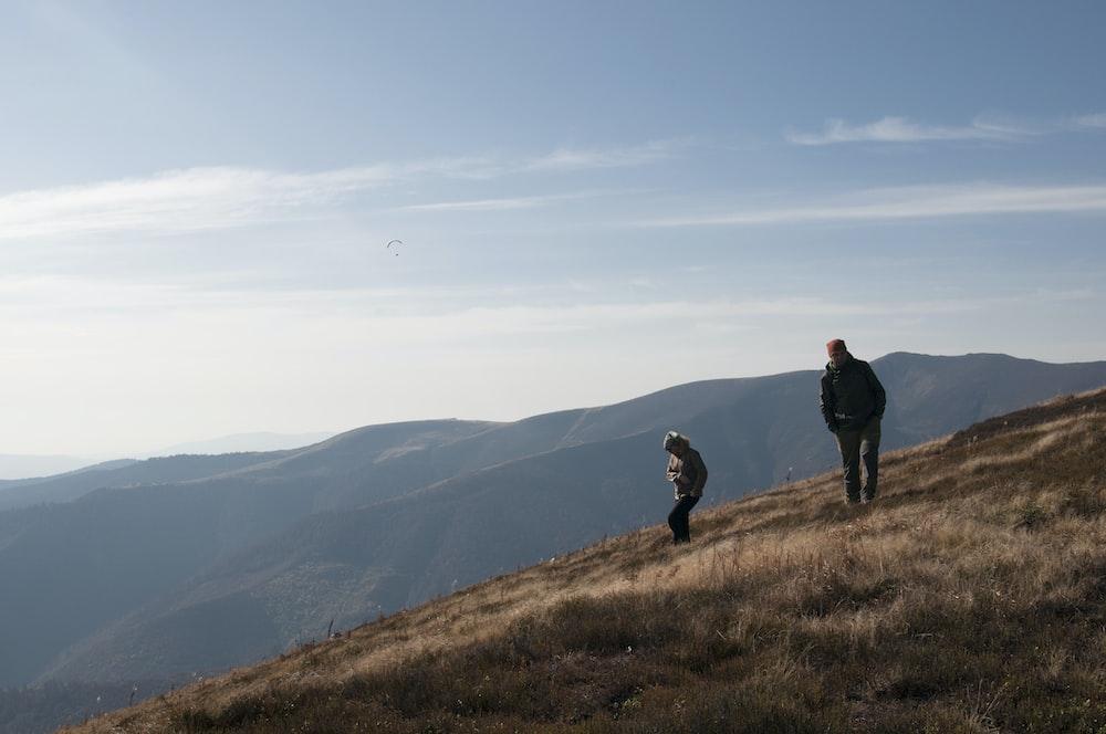 two person climbing mountain