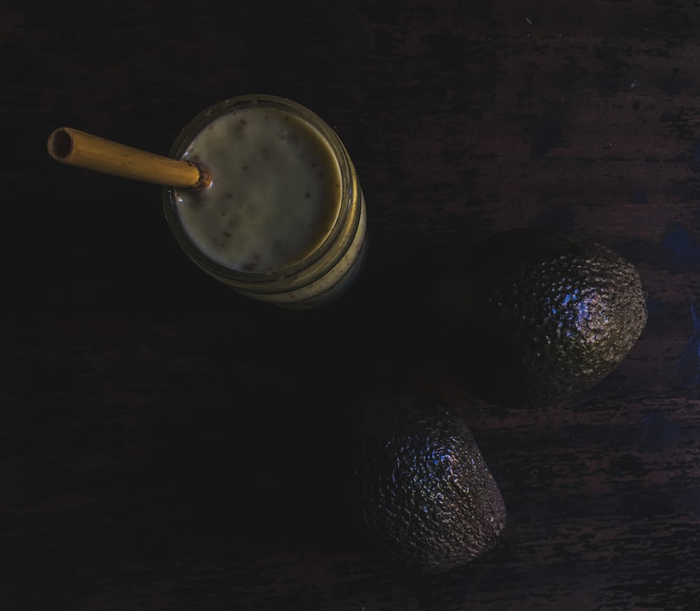 avocado drink placed on wood
