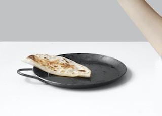 person holding pancake raising it up