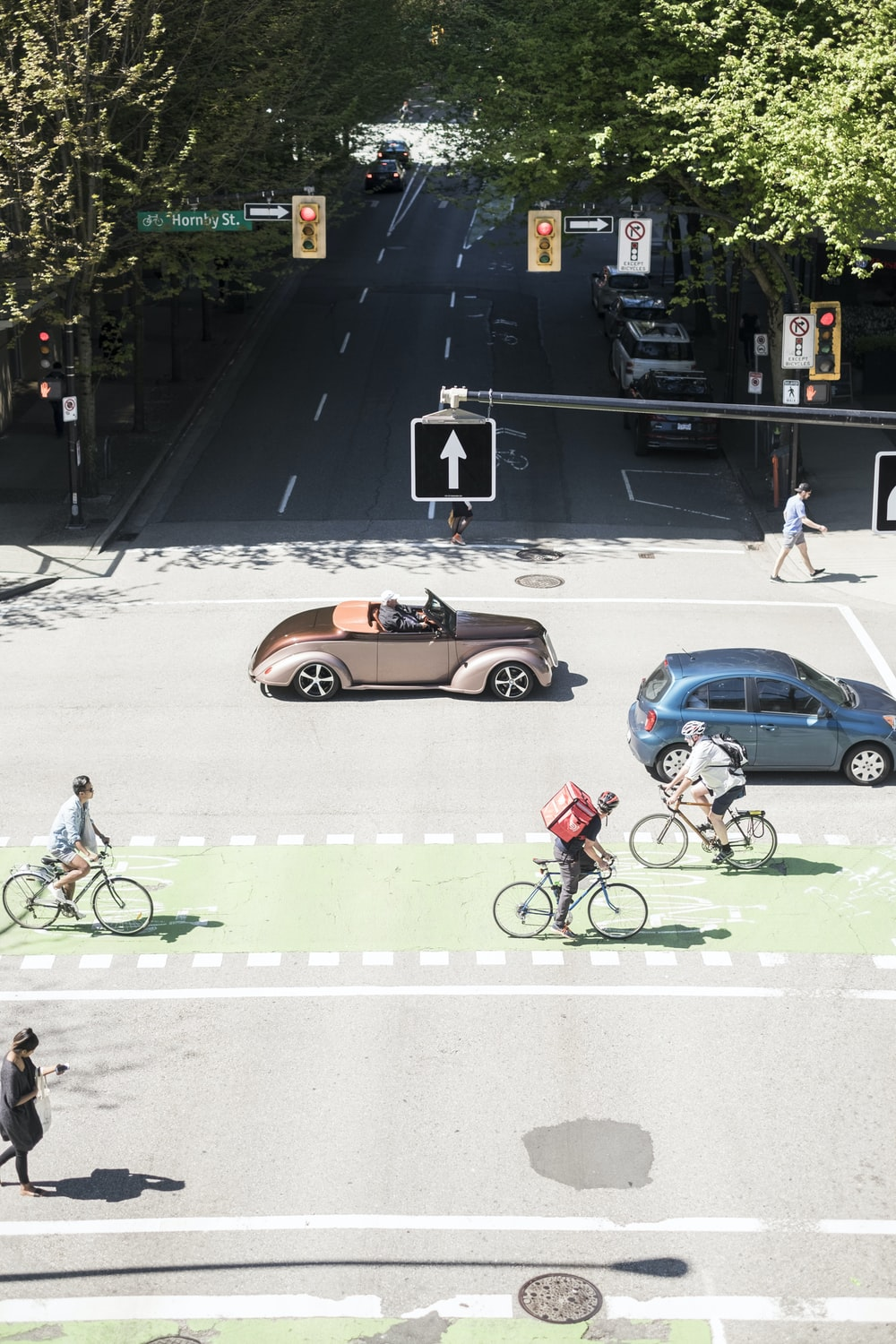 vehicles and bikes on road during daytime