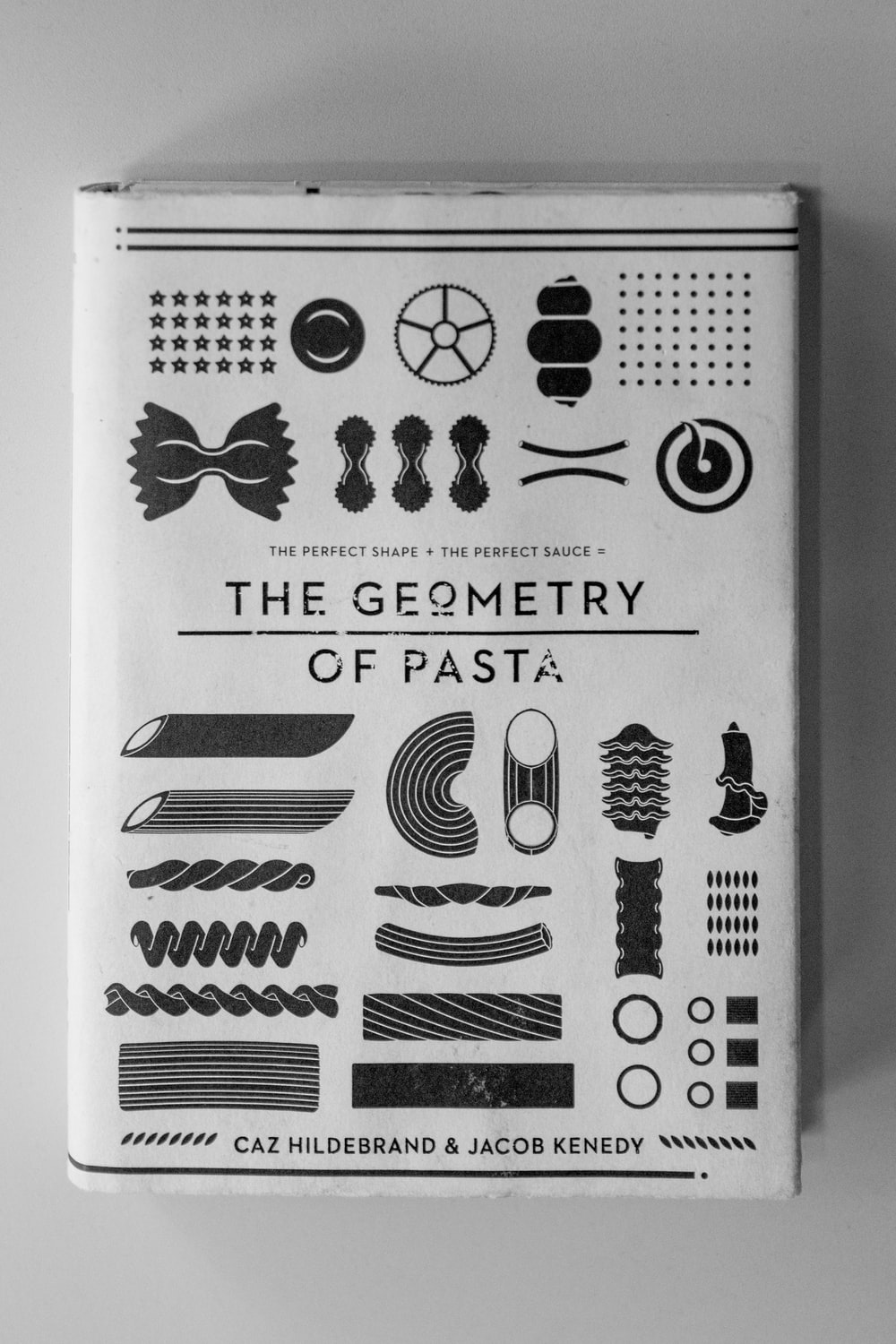 The Geometry of Pasta book on white surface