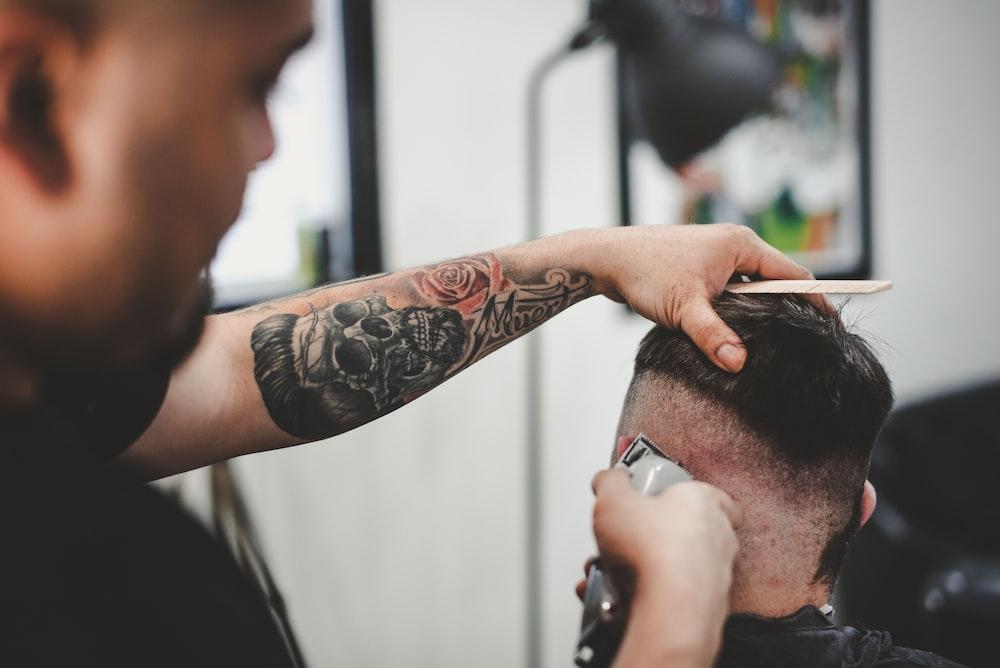 man cutting hair of man