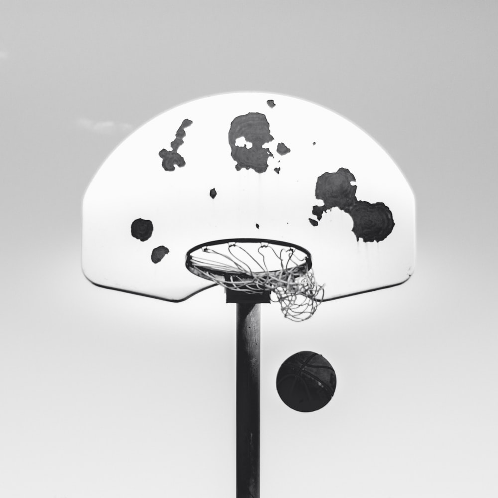 grayscale photography of basketball system and ball