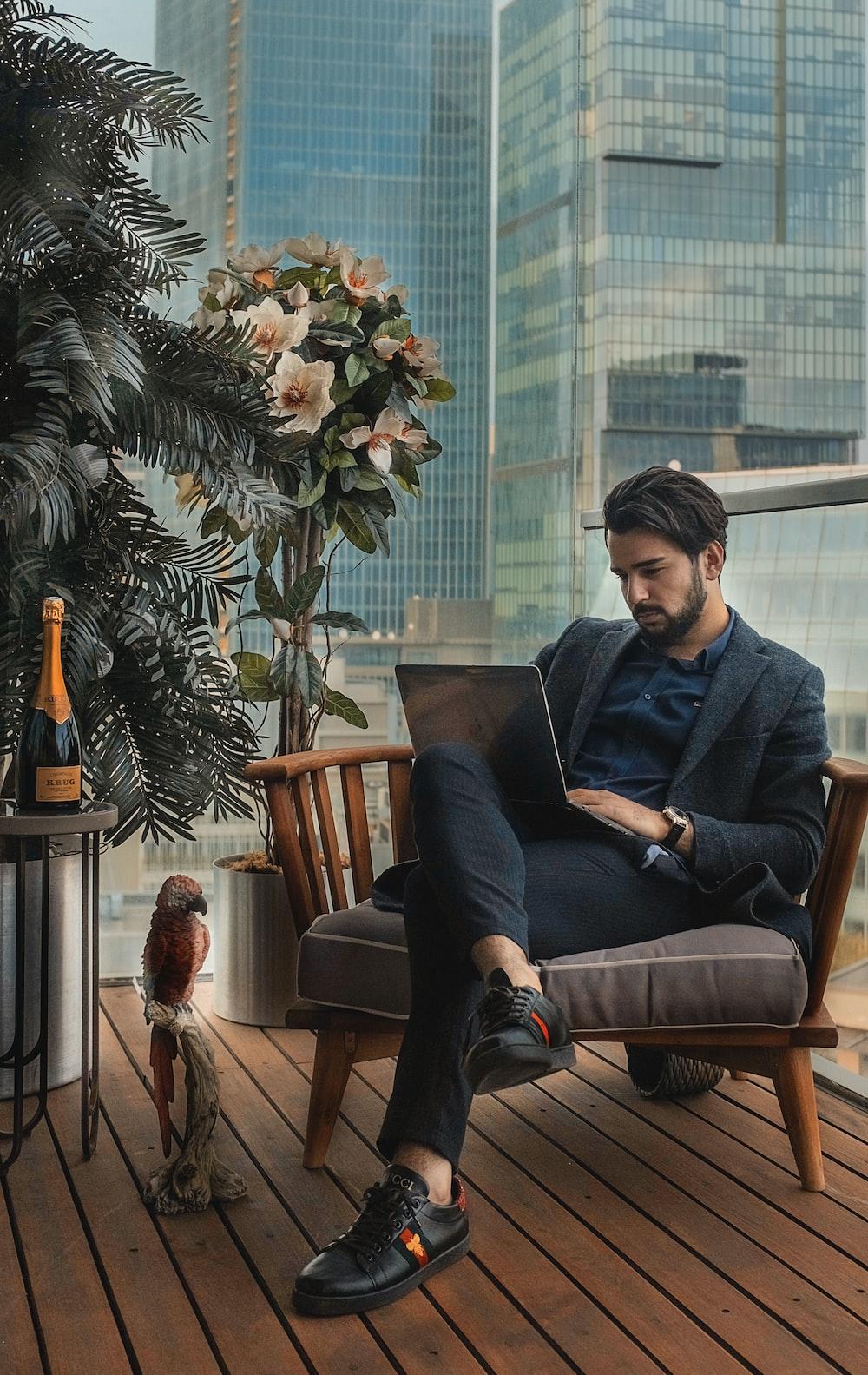 man sitting beside side table