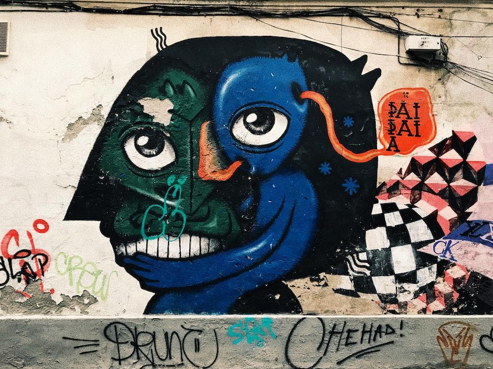 black, blue, and green graffiti