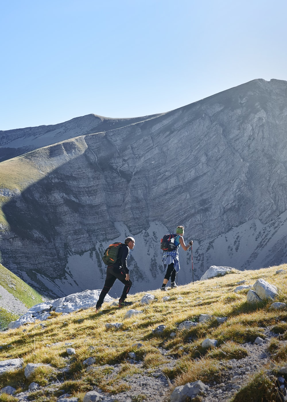 two people walking on mountain