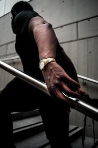 man holding a handrails