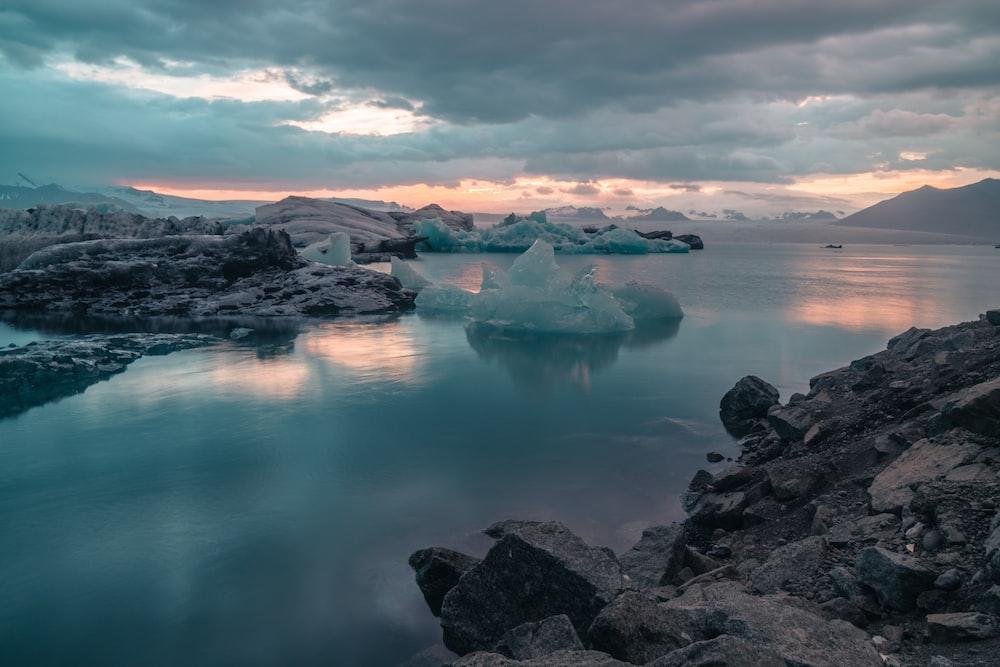 ice berg in body of water