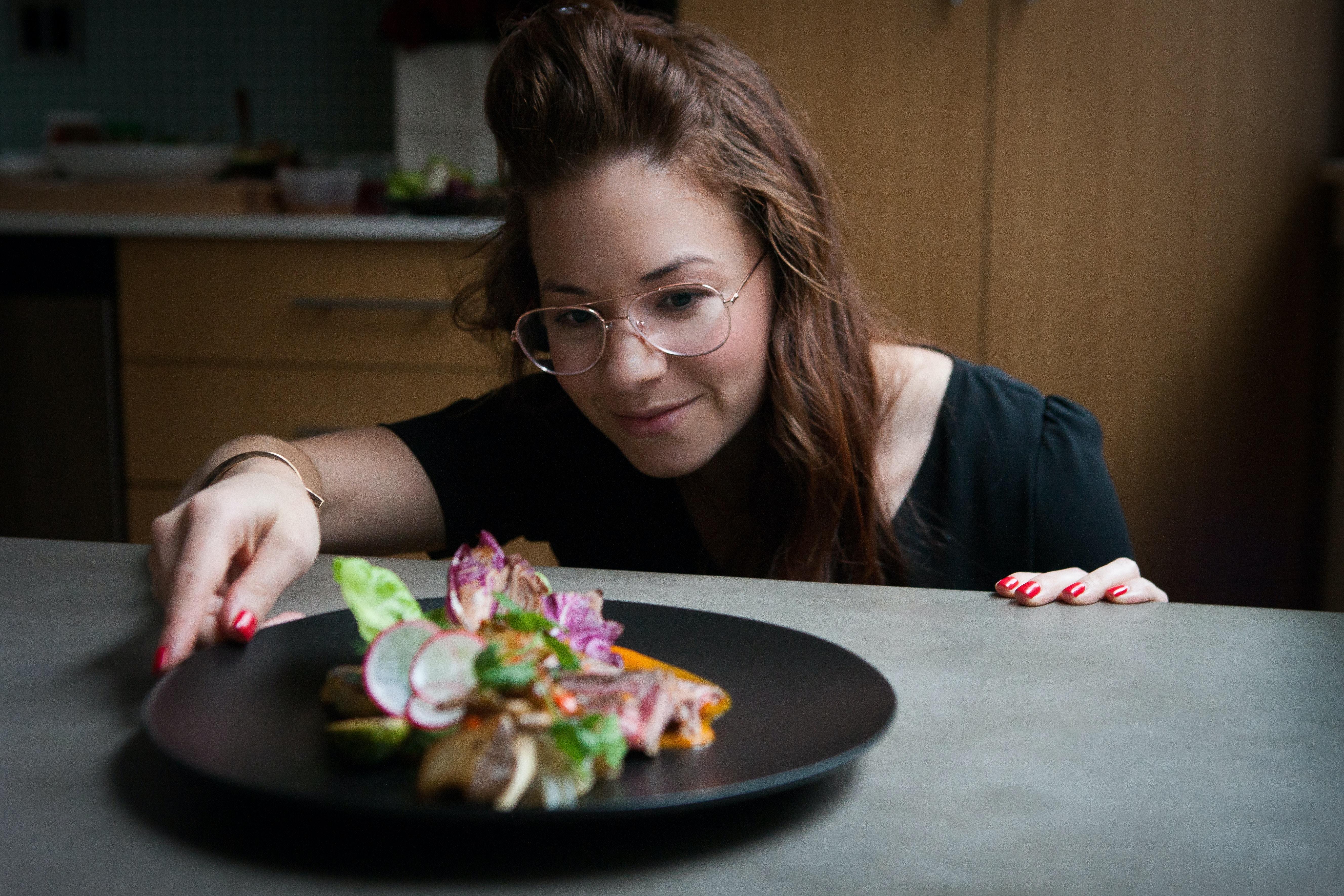 woman looking dish