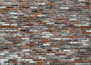 brown, white, and grey brick wall