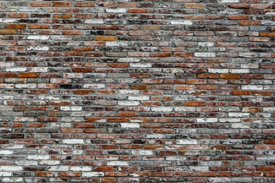 brown, white, and grey brick wall
