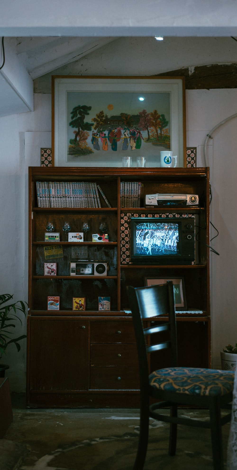brown wooden television hutch near white wall