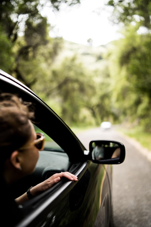 woman sitting inside vehicle