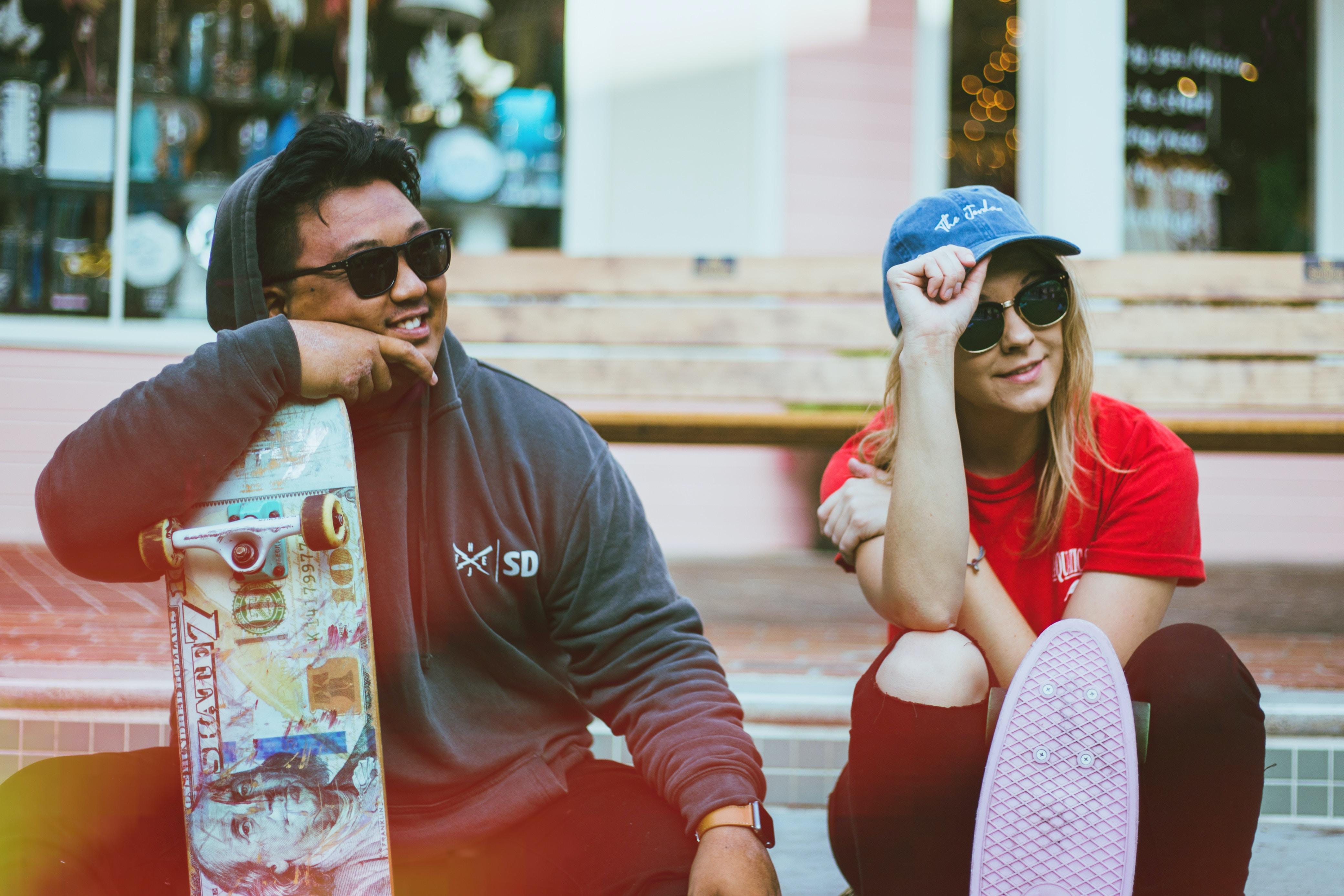 man and woman wearing black sunglasses