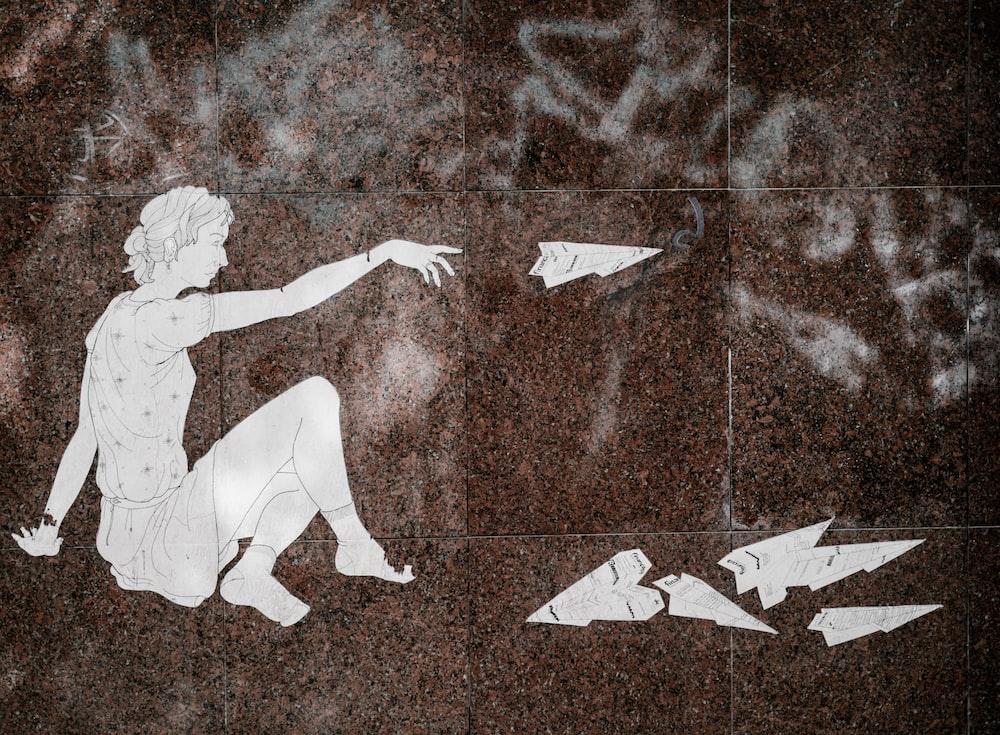 man throwing arrowhead stone illustration