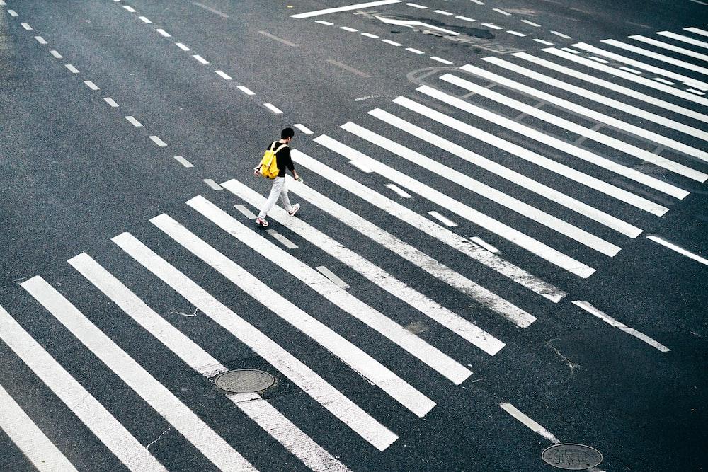 person walking on pedestrian lane during daytime