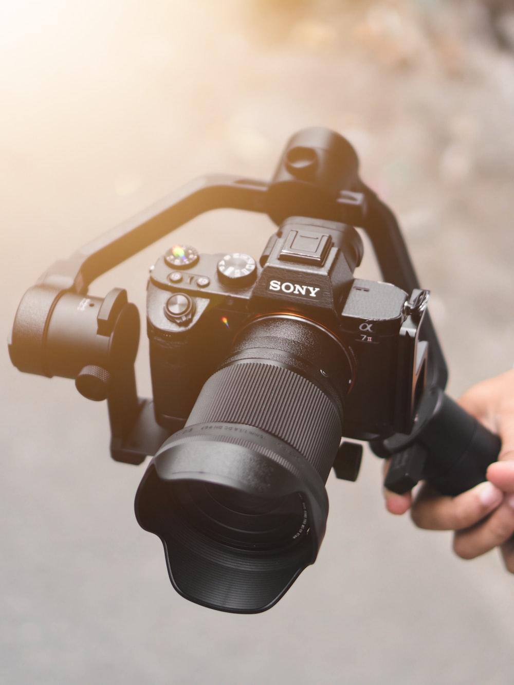 black Sony DSLR camera with stabilizer