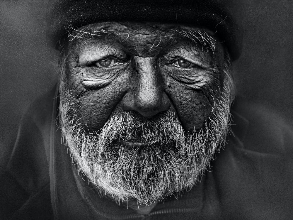 grayscale photography of man's face