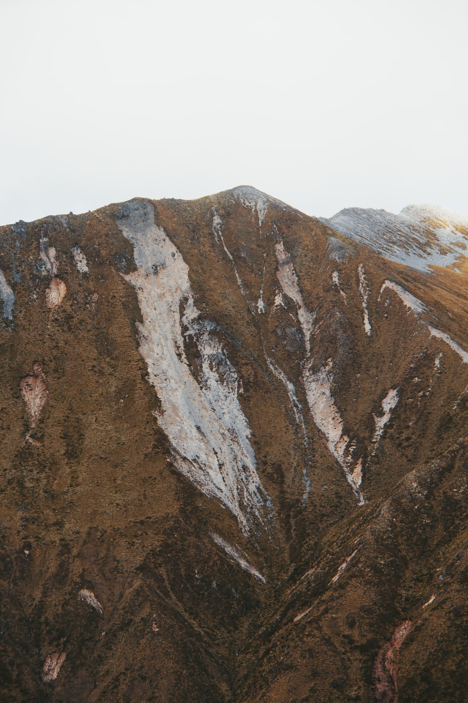 mountain under white sky during daytime