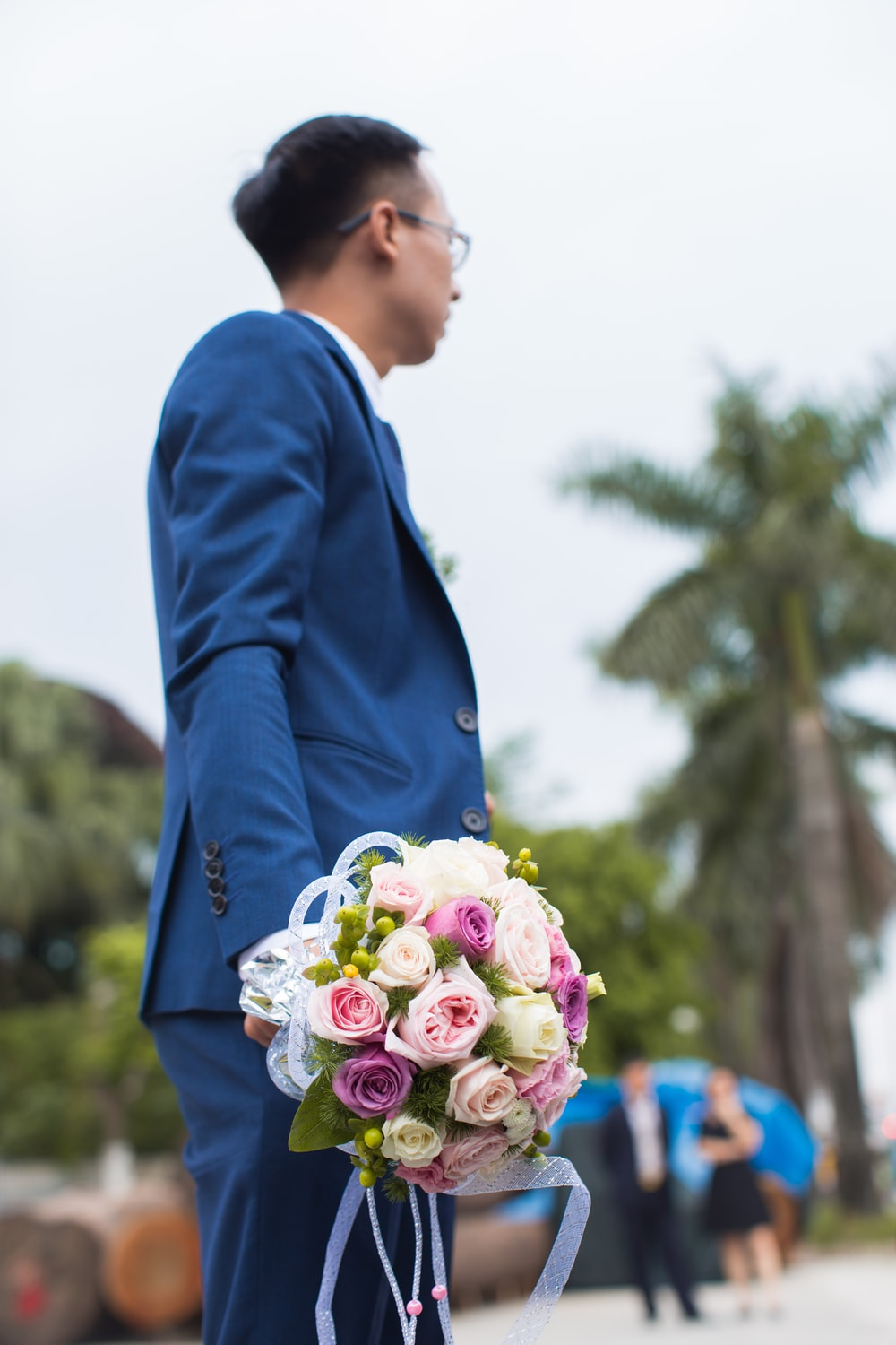 man holding bouquet of flower