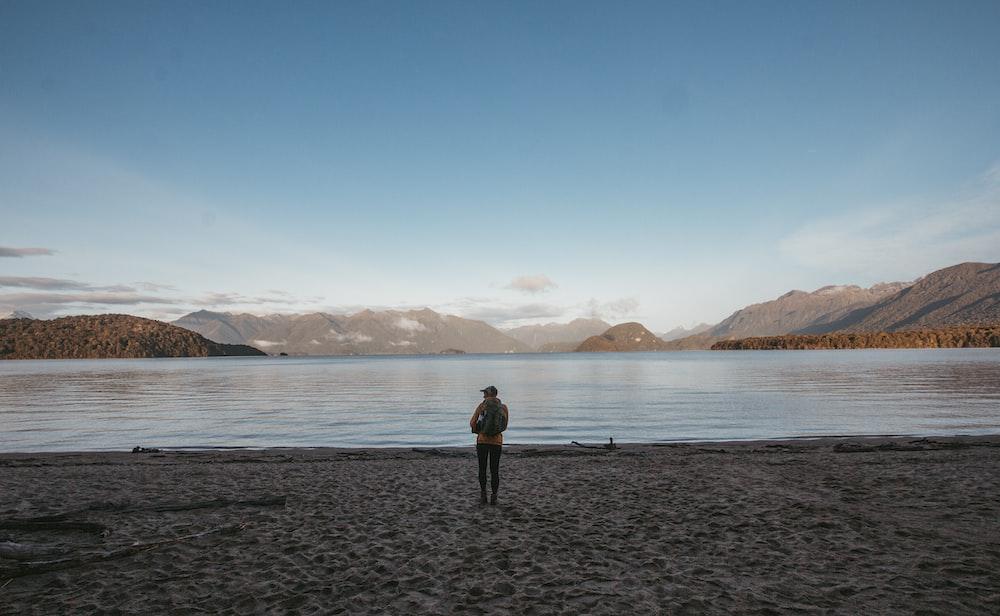 man stands in beach