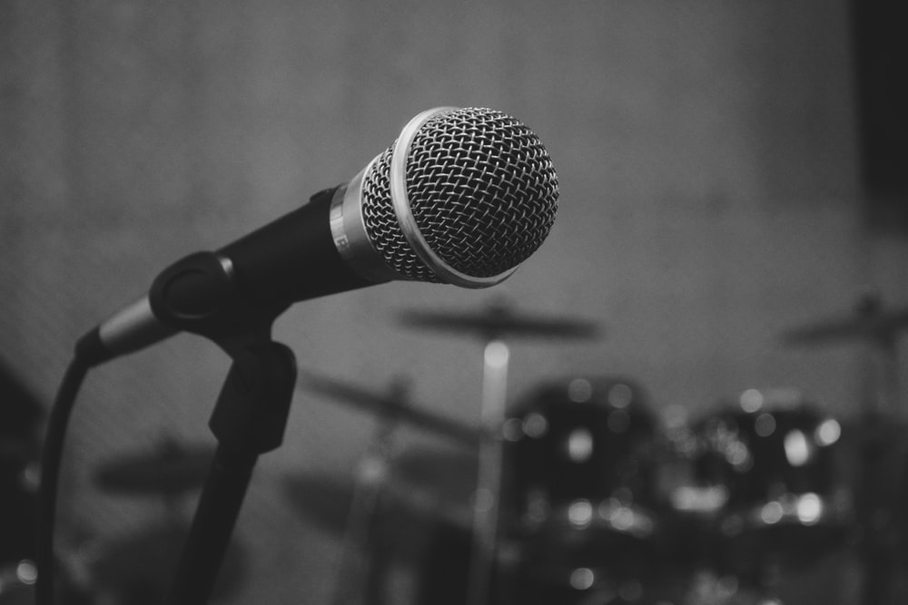 black and grey microphone on stand