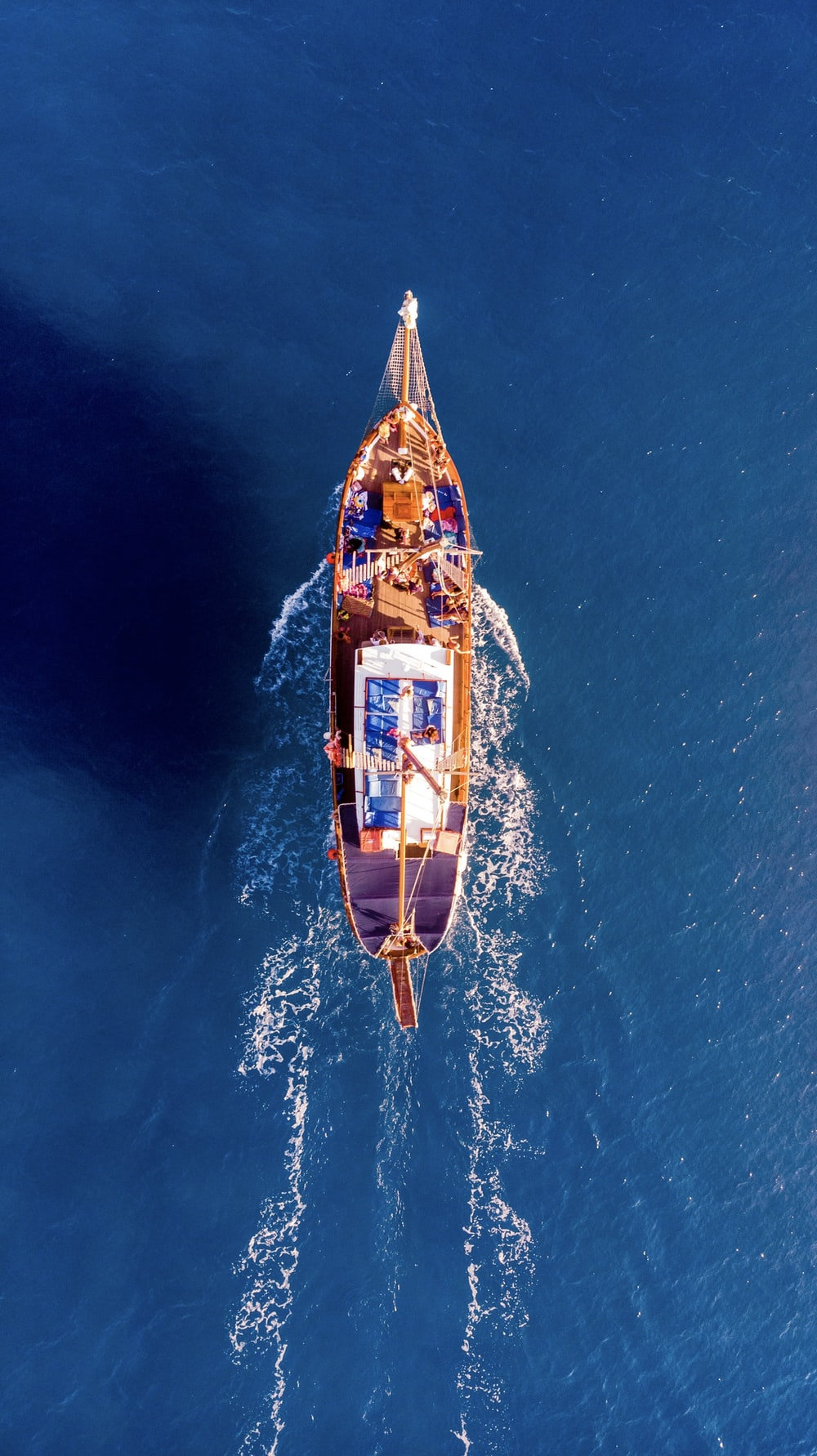 aerial photography of boat on blue ocean during daytime