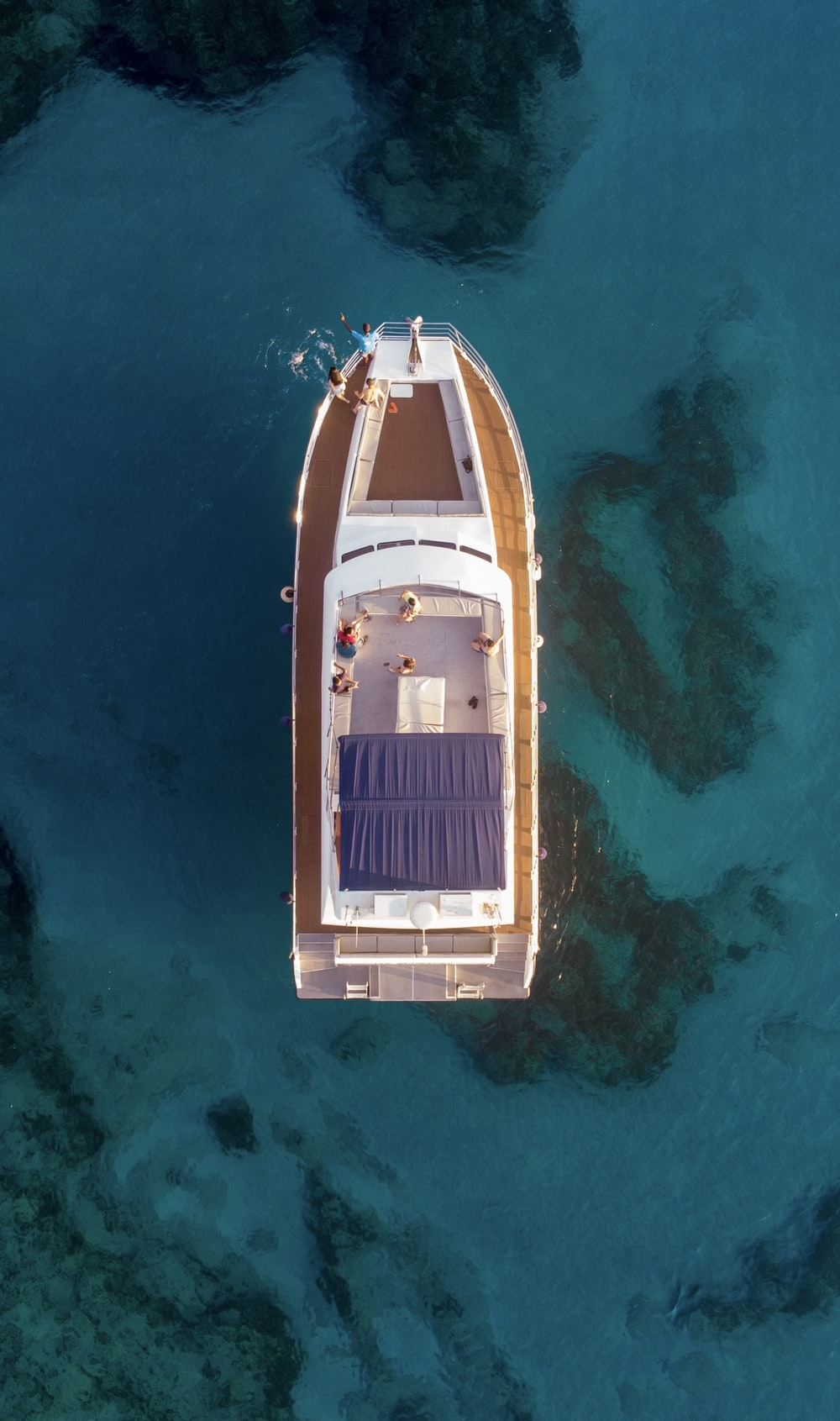 aerial photography of white and brown boat on water