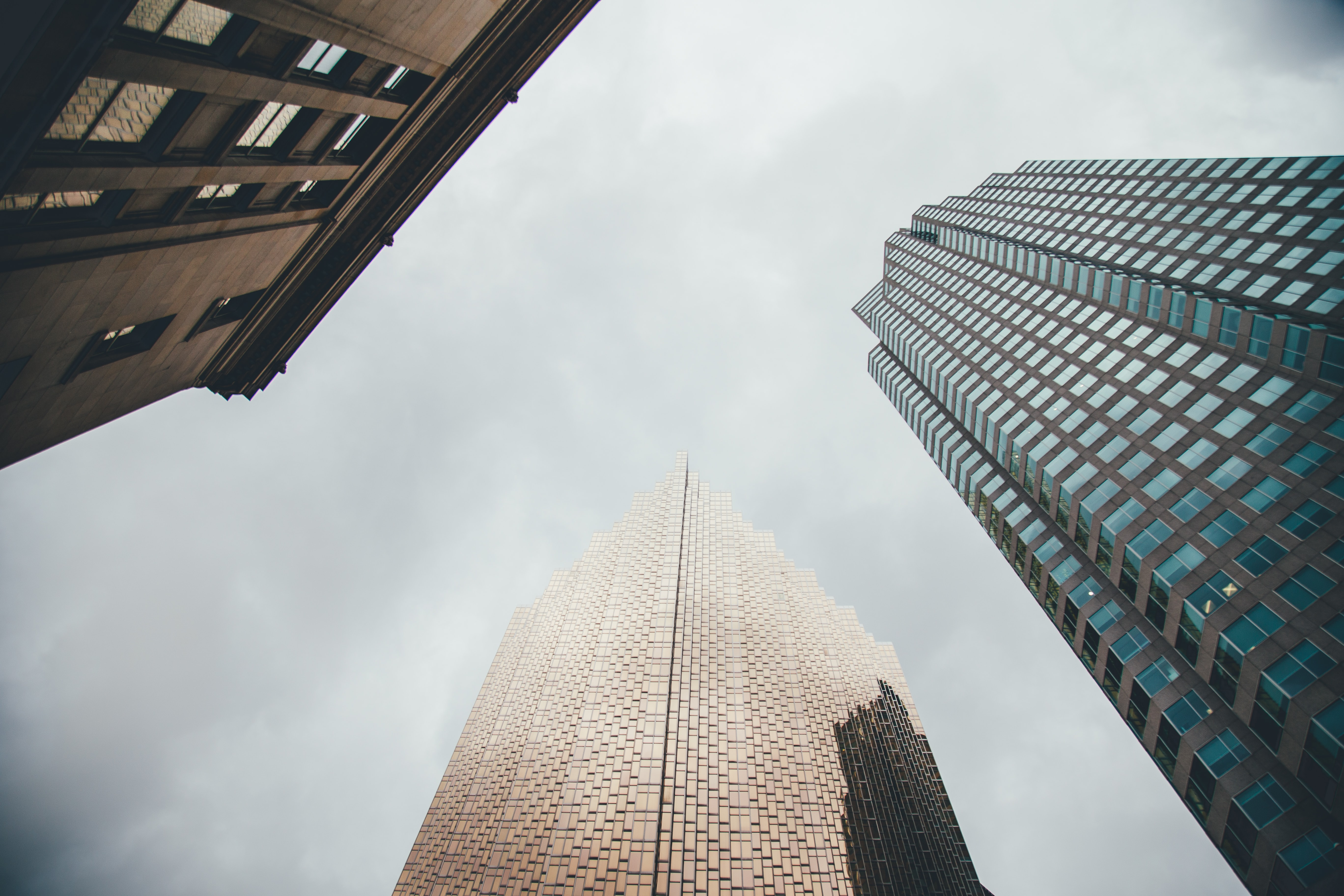 low angle photography of three high-rise buildings