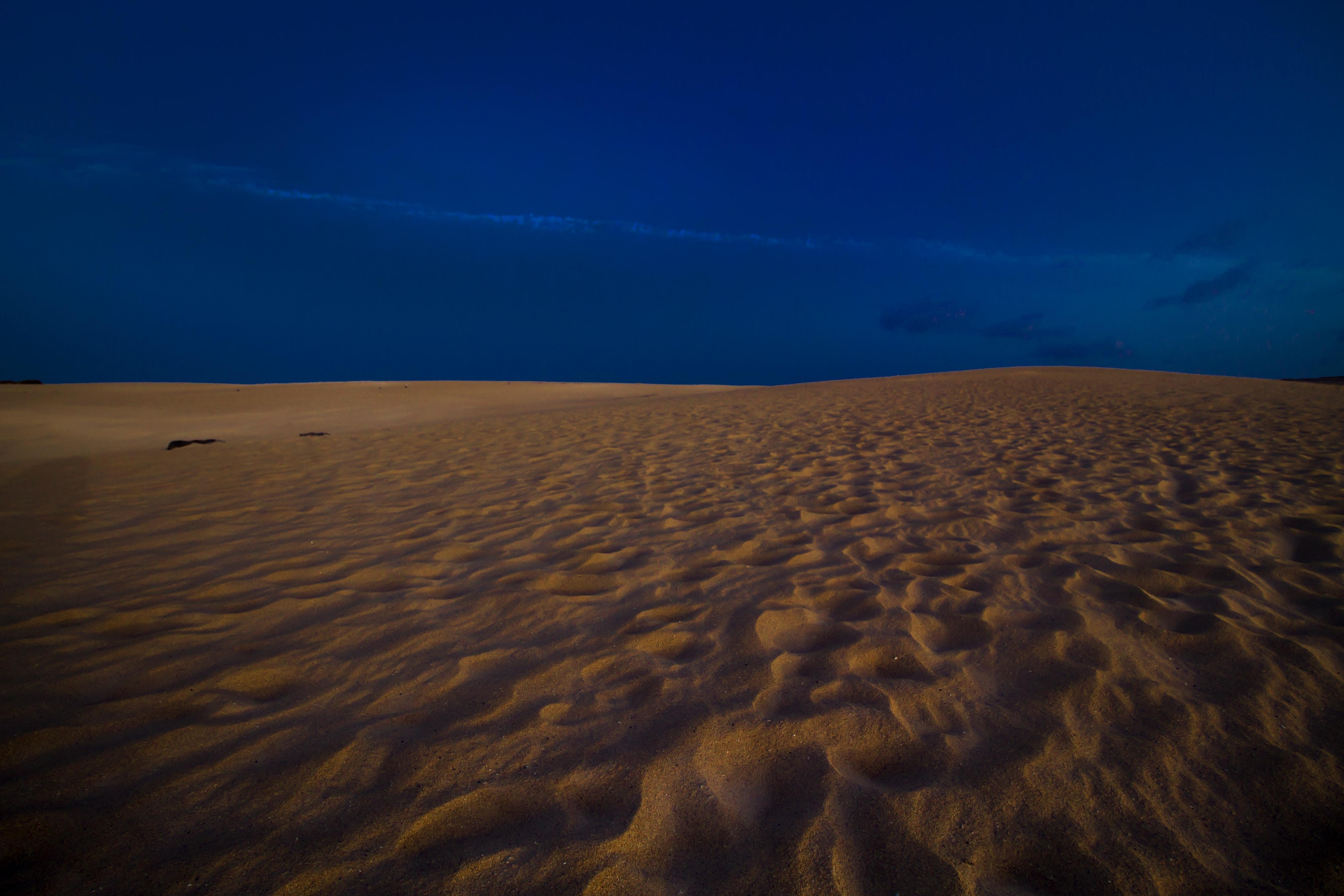 sandy area under blue sky