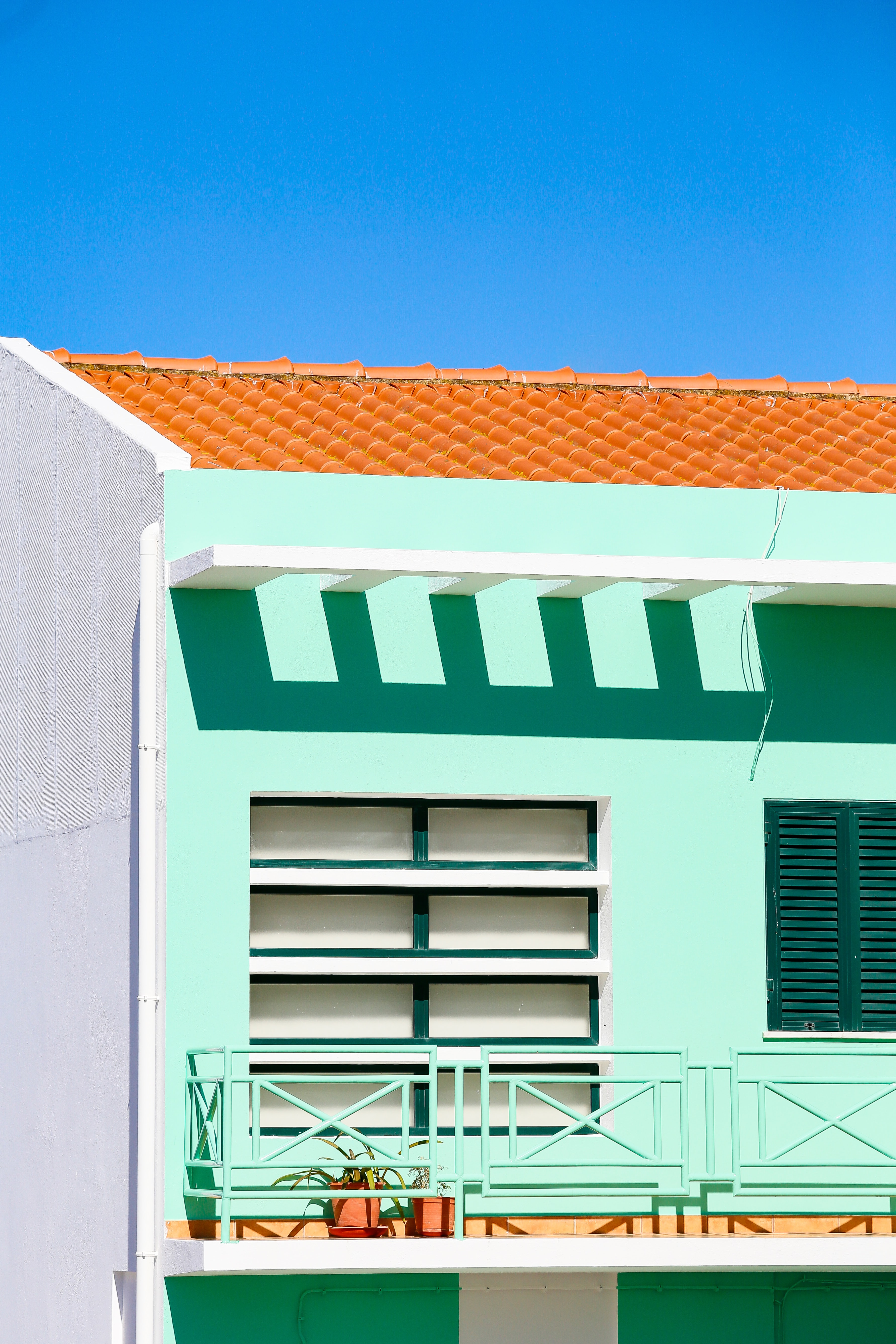 green and white concrete building under blue sky