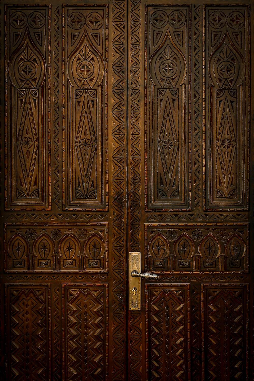 brown wooden engraved french door panels