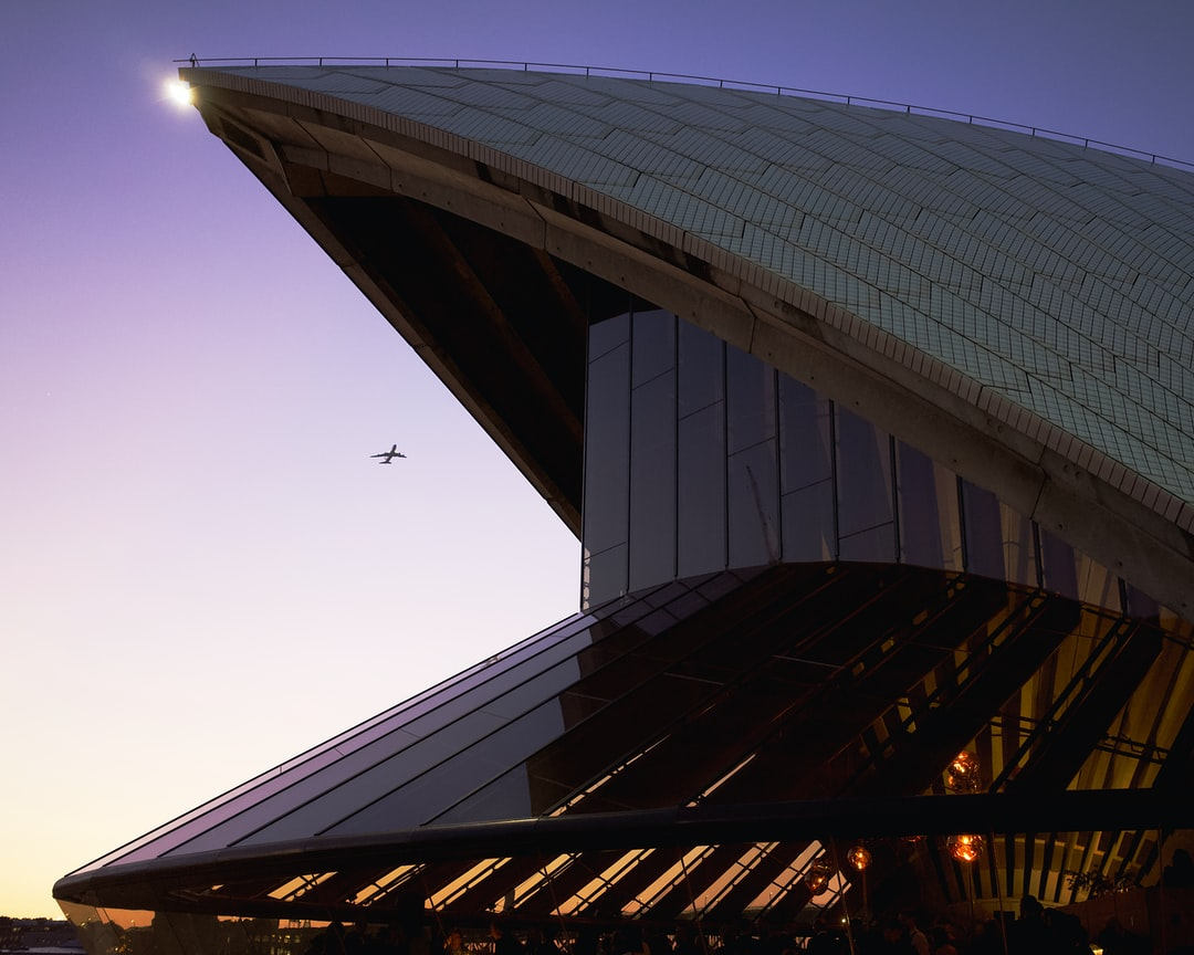 Sitting on the Sydney Opera House Stairs I noticed airplane taking off. The building looked like giant Pac Man. Trying to eat the airplane.