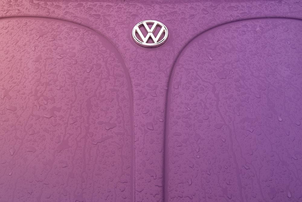 pink Volkswagen Beetle hood