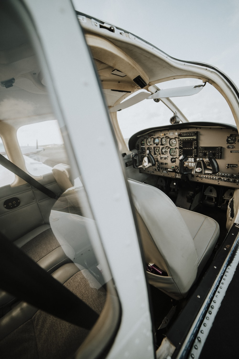 close-up photography of white plane seat