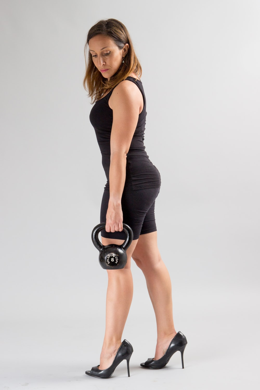 woman carrying kettlebell