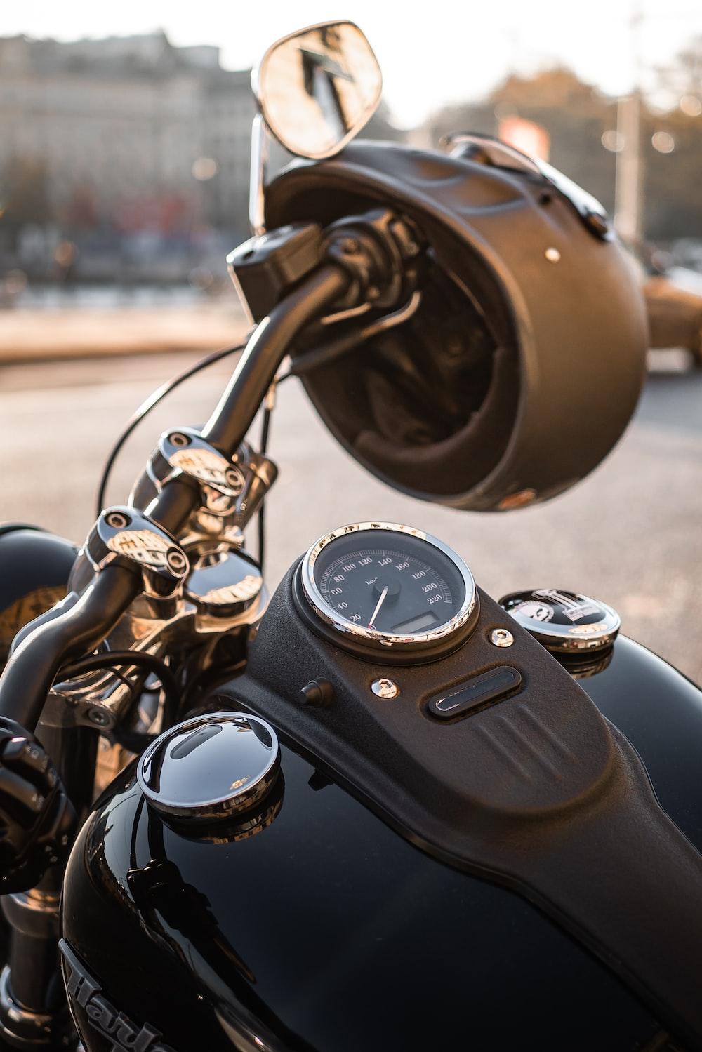 black motorcycle and black motorcycle helmet