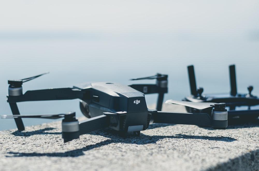 black DJI Mavi drone beside controller