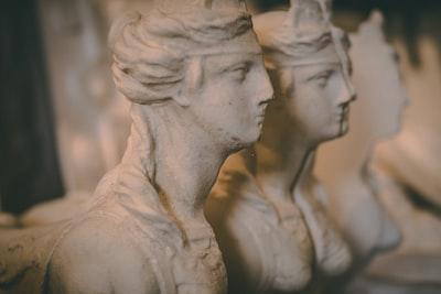 three concrete head busts