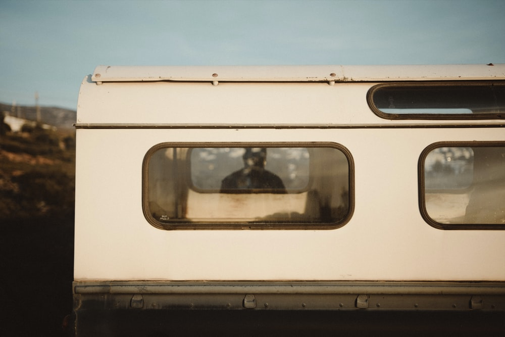 white vehicle camper shell